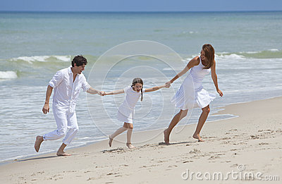 Family Running and Having Fun At the Beach
