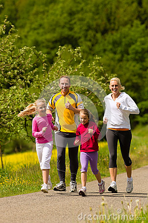 Free Family Running In The Meadow For Sport Royalty Free Stock Images - 29524739