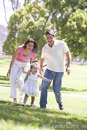 Free Family Running Outdoors Smiling Stock Image - 5771271
