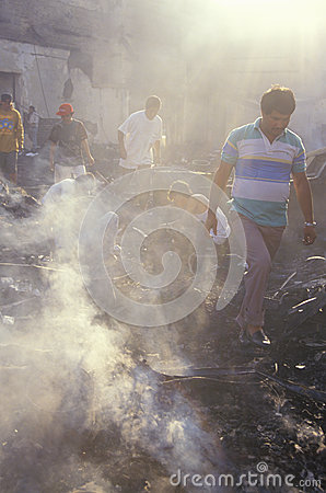 Family salvaging possessions after riots, Editorial Photo