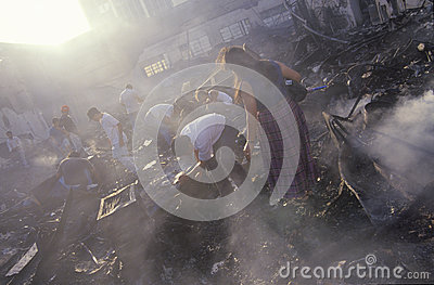 Family salvaging possessions after riots, Editorial Stock Photo
