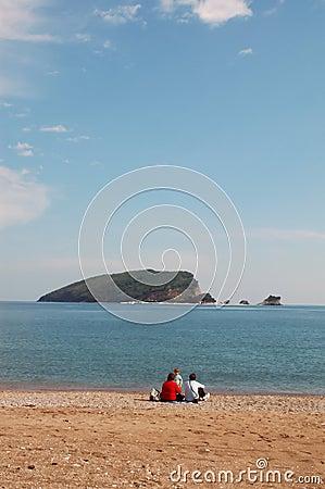 Family sat on beach