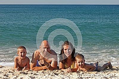 Family on sea beach