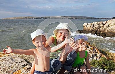 Family on sea coast