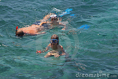 Family in the sea snorkeling