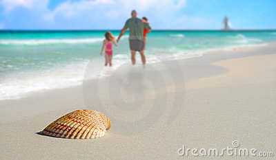 Family by Seashell on Tropical Beach