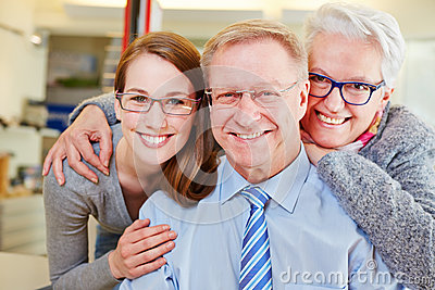 Family with seniors at optician