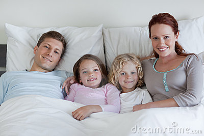 Family sharing the bed