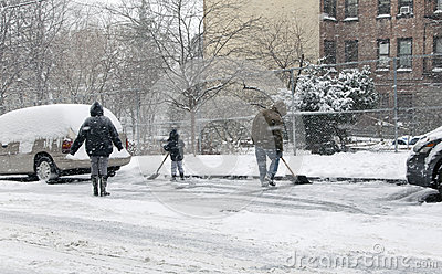 Family shoveling during snow storm in New York Editorial Image