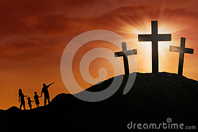 Family silhouette at the Cross