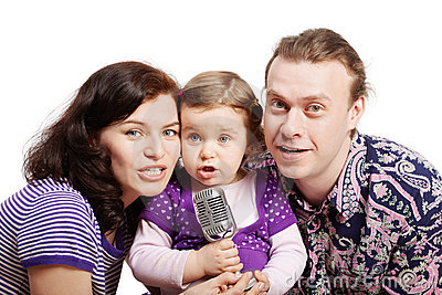 Family sing into microphone Stock Photo