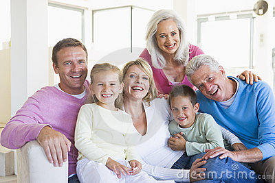 Family sitting indoors smiling