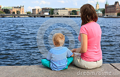 Family sitting on jetty