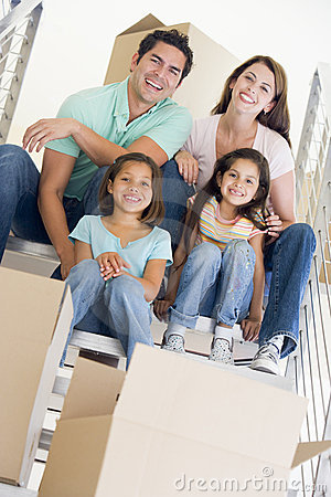 Free Family Sitting On Staircase With Boxes In New Home Stock Photo - 5943130