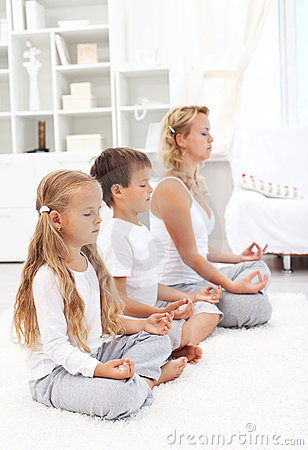 Family sitting in a row meditating