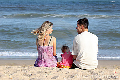 Family sitting on the sand