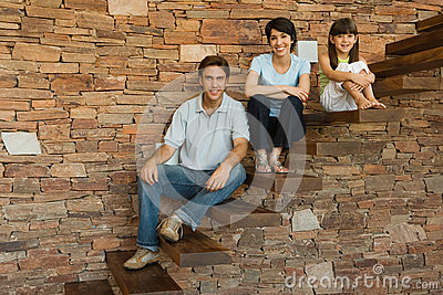 Family sitting on steps