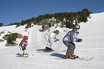 Family is skiing during winter sport