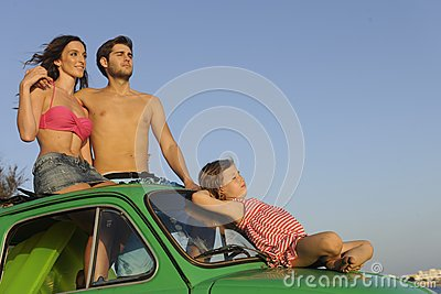 Family with small car on vacation