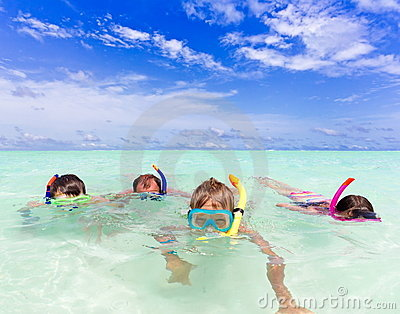 Family snorkeling in the water