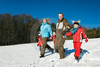 Family in the snow at a hill