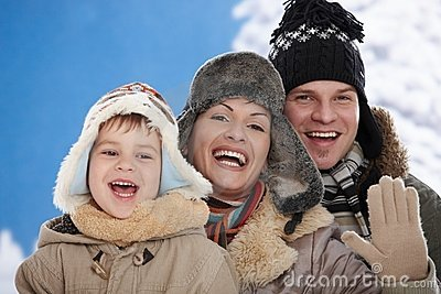 Family in snow at winter