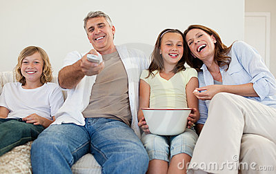 Family on the sofa watching tv
