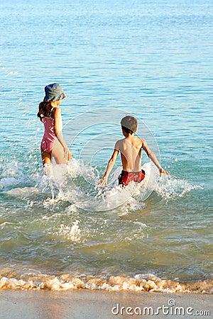 Family splash in warm water.