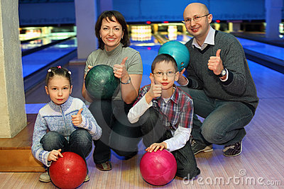 Family of squatting in bowling club