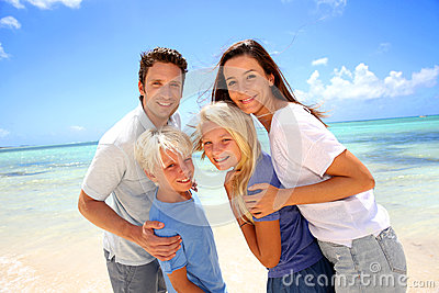 Family standing on a beautiful beach