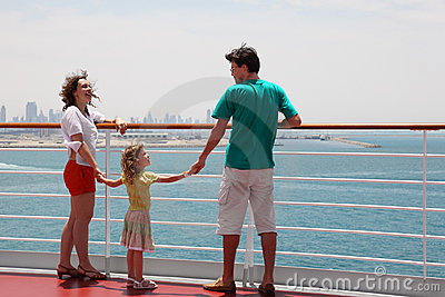 Family standing on cruise liner deck