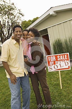 Family Standing In Front Of Billboard