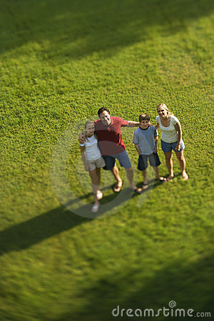 Family standing on lawn.