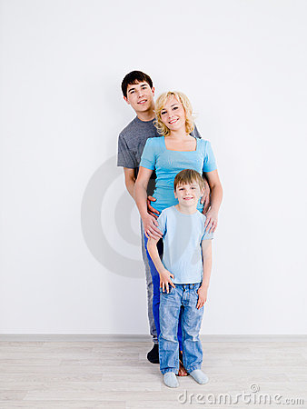 Family standing in line in empty room