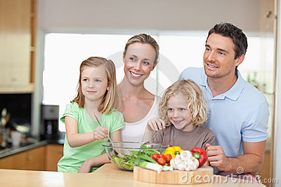 Family standing next to salad