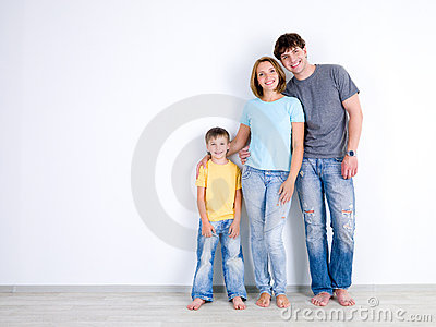 Family standing together near the empty wall