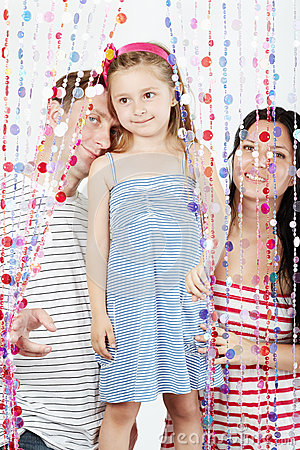 Family strands behind curtains of plastic beads