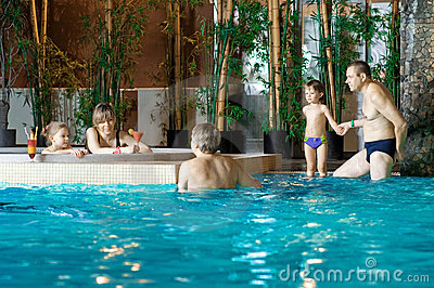 Family in swimming-pool