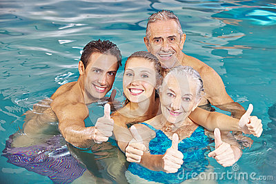 Family in swimming pool holding