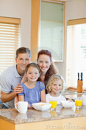 Family with their breakfast in the kitchen