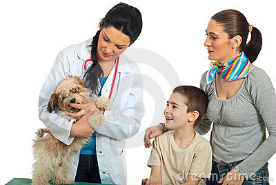 Family with their dog at vet