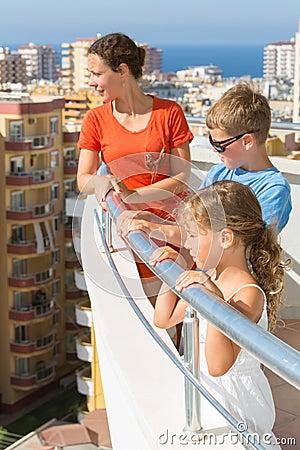 Family of three on the balcony of the room