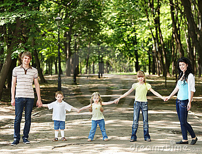 Family with three children  outdoor.