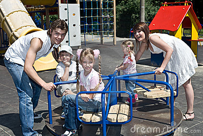 Family and three children in park.