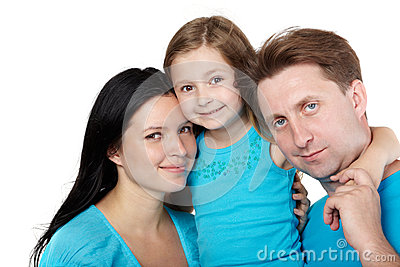 Family of three, daughter hugs her parents