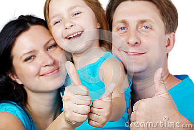 Family of three gives their thumbs up