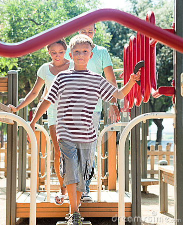 Family of three overcomes  obstacle course