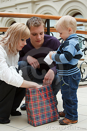 Family from three persons looking at package
