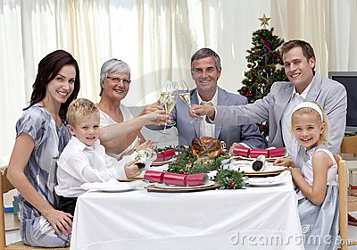 Family toasting in a Christmas dinner