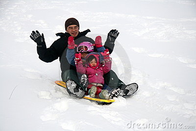 Family tobogganing